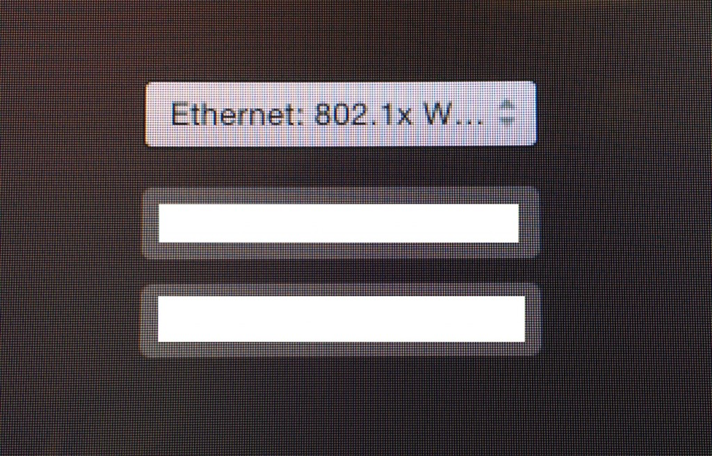 The OS X login window, demonstrating the 802.1x profile in use.